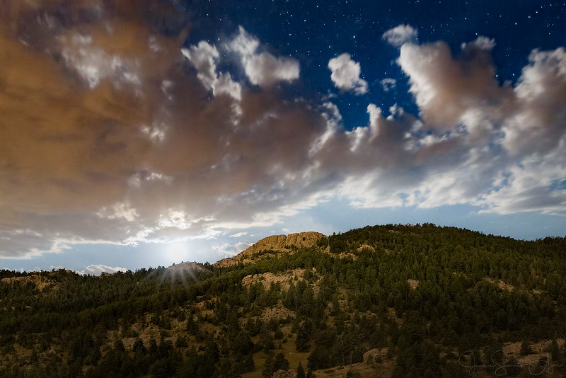Moonset behind Horsetooth Mountain by Jeanie Sumrall-Ajero